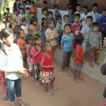 Kids singing to welcome IGS